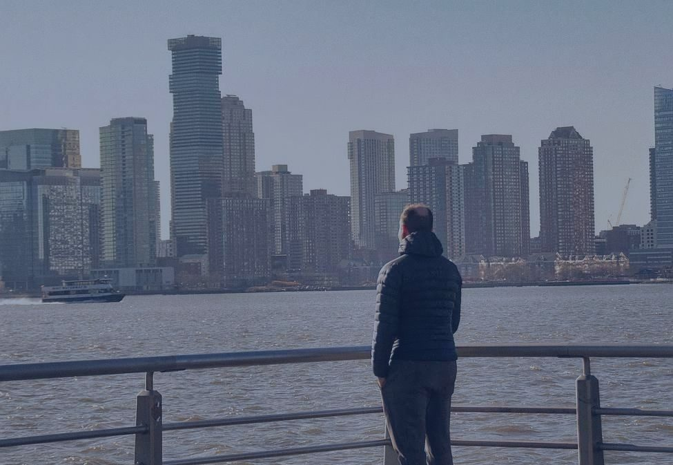 Man with ADHD looking at the New Jersey Skyline.